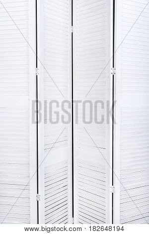 White Wooden Screen For Changing Clothes With A Texture For The Background. Vertical Frame
