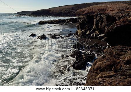 Wild beaches of sand and rocks, Aguimes coast, Gran canaria, Canary islands