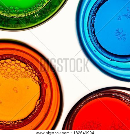 Top view of four empty colored glasses