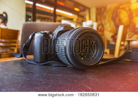 DSL Camera on table - Blurred Background