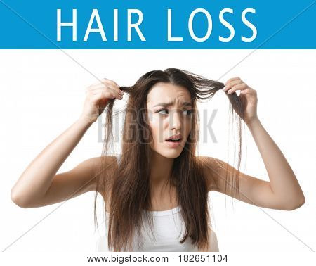 Hair loss concept. Young woman on white background
