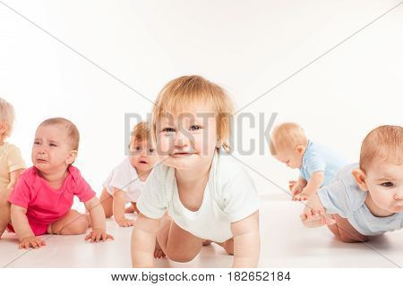Witty babies crawling race isolated on white background. The concept of competition