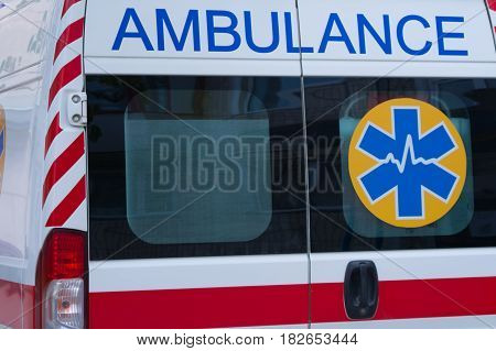 The back door of the ambulance. The word ambulance.