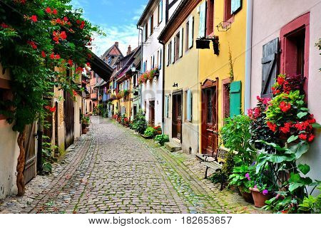 Picturesque Street In The Of The Town Of Eguisheim, Alsace, France