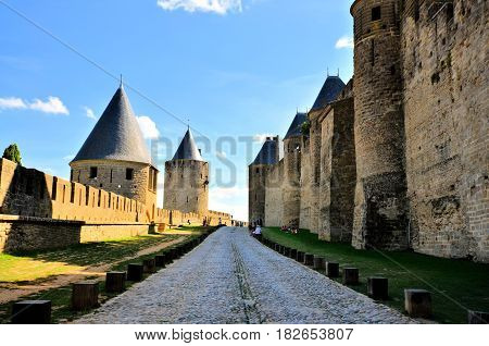 View Down The Moat Of The Medieval Walled City Of Carcassonne, France