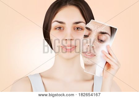 brunette female model releases her skin from wrinkles
