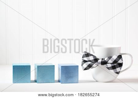 Mug With Bowtie And Blue Wooden Blocks