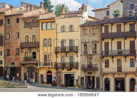 Narrow four storey buildings on the East corner of the sloping Piazza Grande - Arezzo, Italy, 24 September 2011