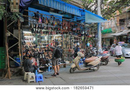 HANOI VIETNAM - NOVEMBER 24, 2016: Unidentified people visit a shoe shop in Old Quarter.