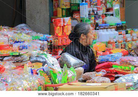 HANOI VIETNAM - NOVEMBER 24, 2016: Unidentified people sells snacks in Old Quarter.