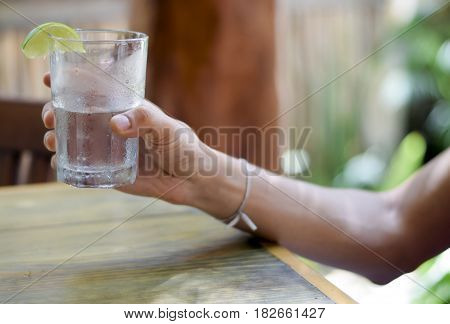 Male Hand Holding Water Glass