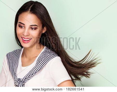 Happy beautiful african american woman smiling. Studio shot