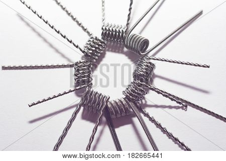 e cigarette coil on isolated white background composition photograph