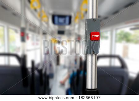 Bus stop button with empty seats with blur background