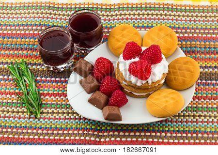 Fresh Red Raspberries On A White Artistic Plate / Red Fresh Raspberries On A White Artistic Plate Wi