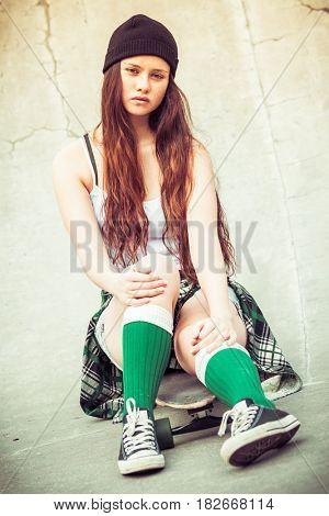 Teen skater girl with vintage filter