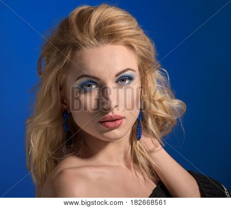 Glamour portrait of beautiful female model with evening make-up