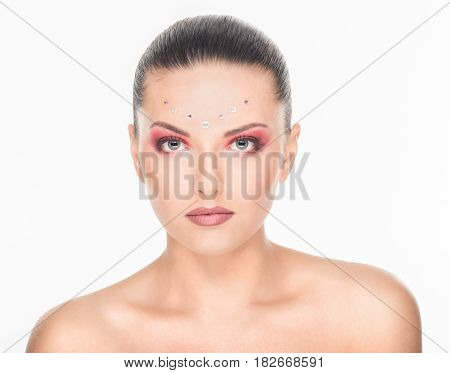 Beautiful young woman with bright designer make-up with rhinestones