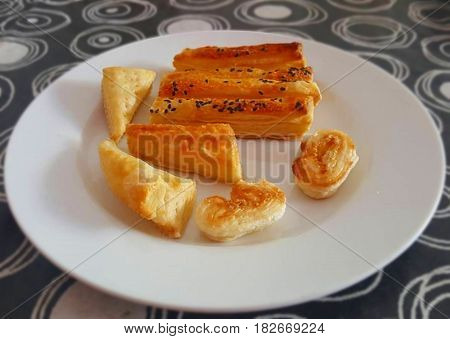 Delicious puff pastry snack. A plate of puff pastry