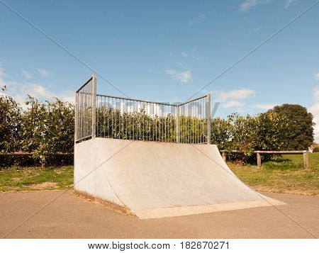 An Empty And Unused Ramp Half Pipe At The Skate Park In The Country Park In The Uk Shining In The Su