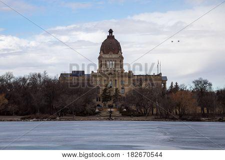 The Saskatchewan Legislative building as seen from the shore of Wascana Lake in Regina Saskatchewan.