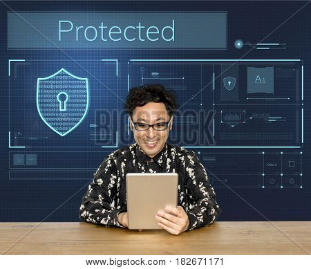 Man working on digital device network graphic overlay banner