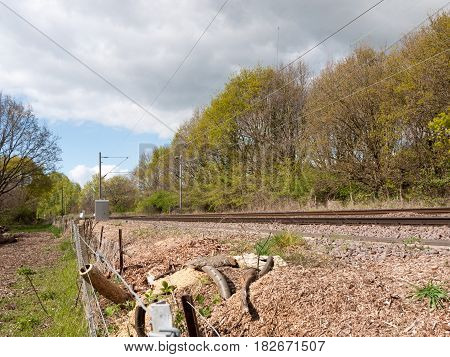 A Railway Track In The Countryside In The Uk With No Train And A Barbed Wire Fence And Trees In Back