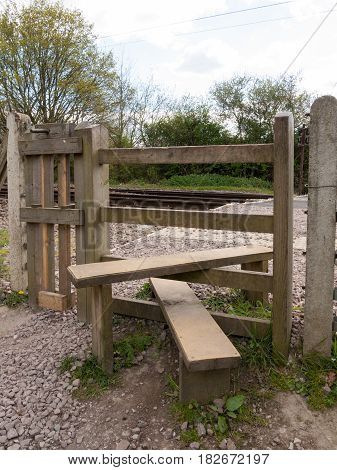 The Wooden Crossing Over A Railway Track, The Planks To Cross Over The Path With Gate And Fence