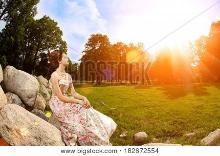 A woman like a princess in an vintage dress in nature