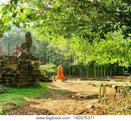 Buddhist Monk Coming Out Of Bayon Temple In Angkor, Cambodia