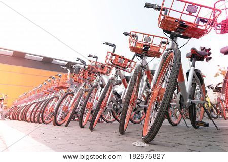 SHANGHAI CHINA - APRIL 2017: A parking lot of bicycle for sightseeing traveler