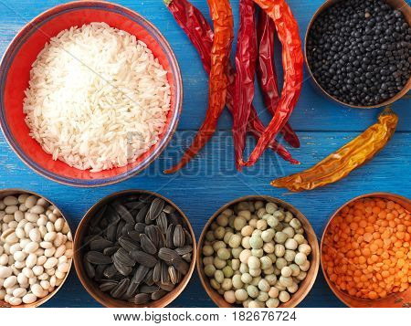 Colorful food ingredients on a blue wooden kitchen table