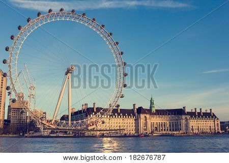 London UK - March 02 2017: London Eye near County Hall at sunset. View from the Victoria Embankment.