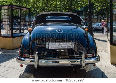 BERLIN - JUNE 05 2016: Full-size luxury car Mercedes-Benz 300D cabriolet (W186). Rear view. Classic Days Berlin 2016.
