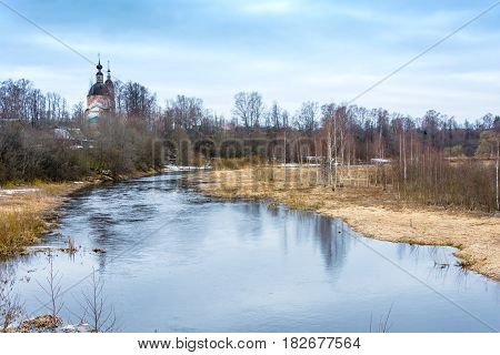 The Old Brick Church On The Banks Of A Small River.