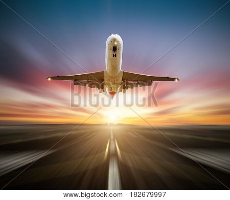 Passengers airplane taking-off the runway, blur motion effect as background. Concept of fast travel and transportation