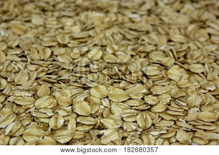 Oat flakes as background, tasty, natural top view
