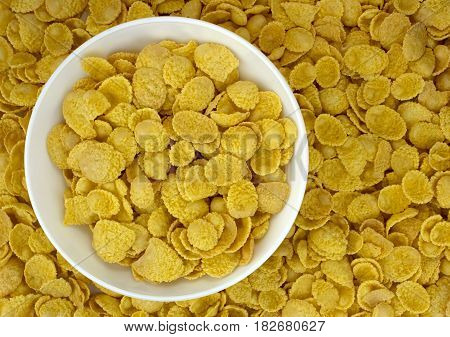 background of goldish corn flakes with dish