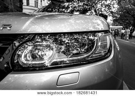 BERLIN - JUNE 05 2016: Headlamp of mid-size luxury SUV Range Rover Sport since 2013. Black and white. Classic Days Berlin 2016.