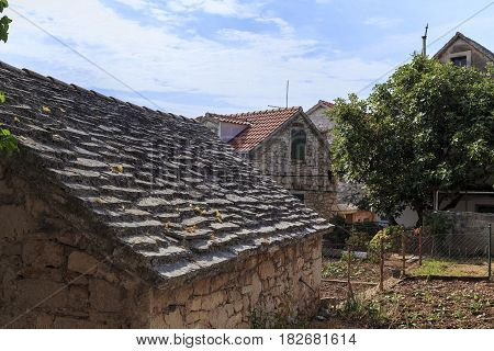 PRIMOSTEN, CROATIA - SEPTEMBER 10, 2016: This is roof of the old house traditionally covered with stone slabs of approximately the same size and thickness.