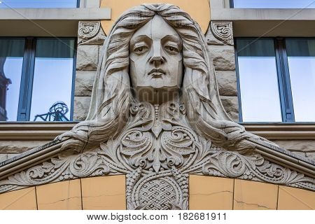 Close up small sculpture on building in Riga city Latvia