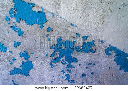 Cracking paint on the wall of abandoned building in Skrunda Soviet military ghost town in Lativa