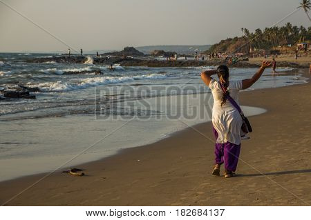 Goa, India - March 4: Happy Indian Woman Is Walking At Little Vagator Beach On March 4, 2017, Goa, I