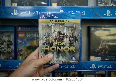 Bratislava, Slovakia, circa april 2017: Man holding For Honor videogame on Sony Playstation 4 console in store