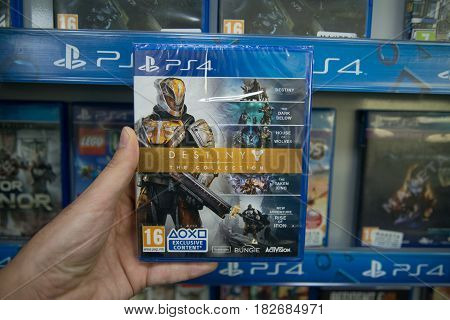 Bratislava, Slovakia, circa april 2017: Man holding Destiny The Collection videogame on Sony Playstation 4 console in store