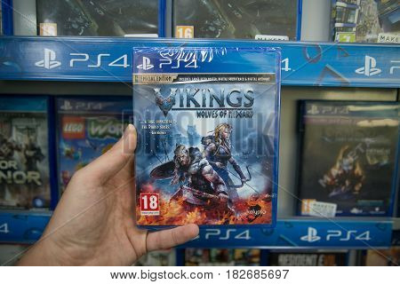 Bratislava, Slovakia, circa april 2017: Man holding Vikings Wolves of Midgard special edition videogame on Sony Playstation 4 console in store