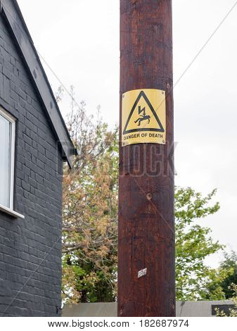 A Yellow And Black Danger Of Death Sign With Electric Bolt And Man Accident Electrified On A Wooden