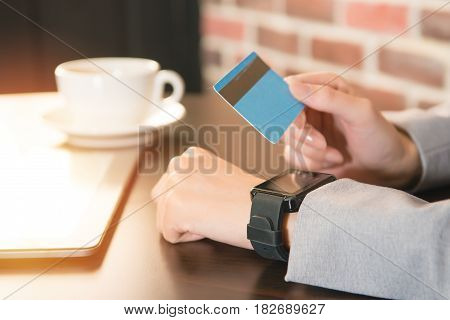 Female Hands Smart Watch And Credit Card