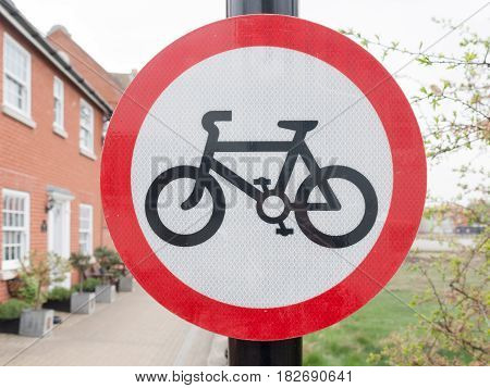A Red Black And White Circle Sign On A Pole Post With A Picture Of A Bike Pedals Wheels Permitted No