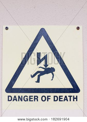 A White Yellow And Black Close Up Sign On The Wall Saying Danger Of Death With Electric Bolt And Dea